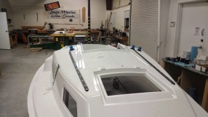 Deck hardware being installed on a Sage 17.