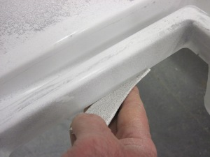 breaking cut edge with sandpaper