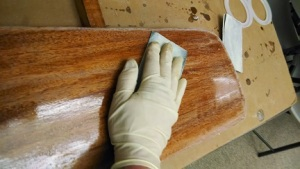Use 220 grit sandpaper between each coat of varnish.