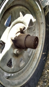 This wheel has traveled about 20,000 miles.  The  BearingBuddy fitting leaks just a bit of grease and makes a mess.