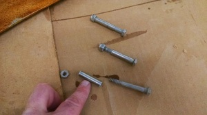 So you don't loose any parts put the compression posts on the removed bolts.