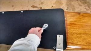 Remove the rudder's pivot bolt.