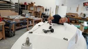 Matt installing cabintop hardware.