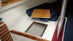 Lift the cushion and the bin cover to access over six cubic feet of storage (each side of the daggerboard trunk so a total of 12 cubic feet!).