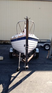 "The trailer is just under 7' wide (fenders); overall length is about 19' 6""; and the height of boat w/mast in trailer crutch position is about 6'8"". The boat & trailer will easily fit in a standard 20' long garage."