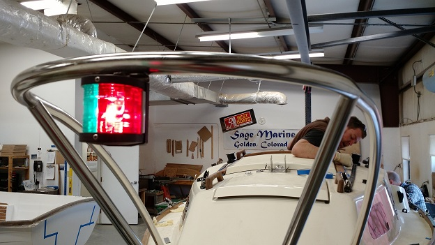 Electrical system test while Greg cleans the deck so the boat looks great for her owner.