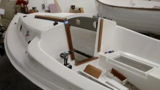 Sage 15 sloop deck hardware and teak being installed.